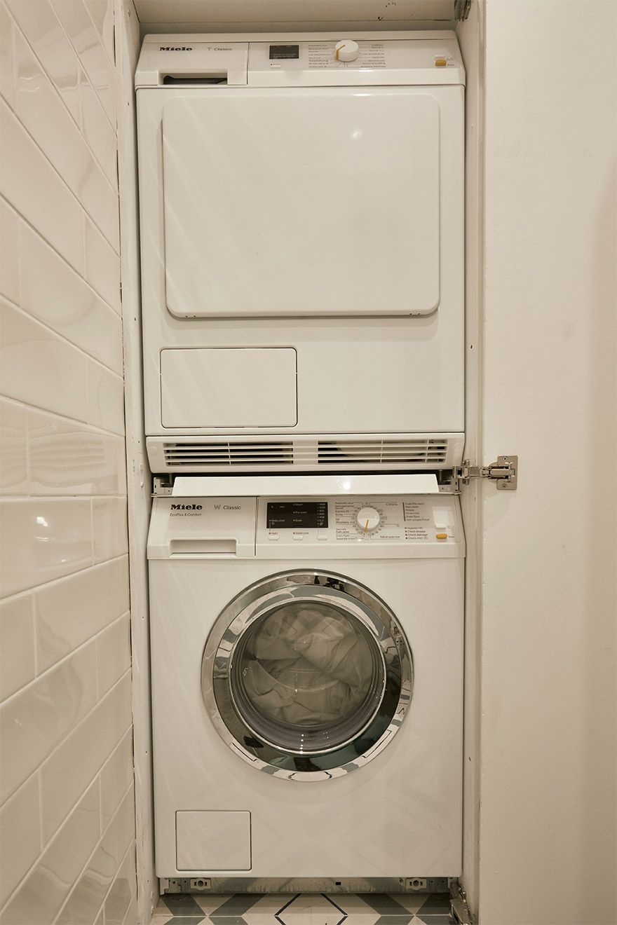 Separate washing machine and dryer in the Danebury vacation rental offered by London Perfect