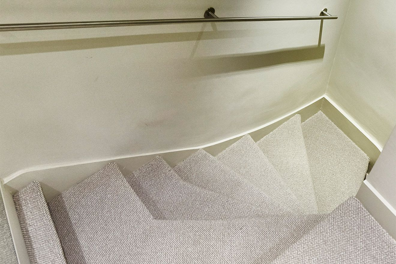 Carpet and handrails on staircase in the Danebury vacation rental offered by London Perfect