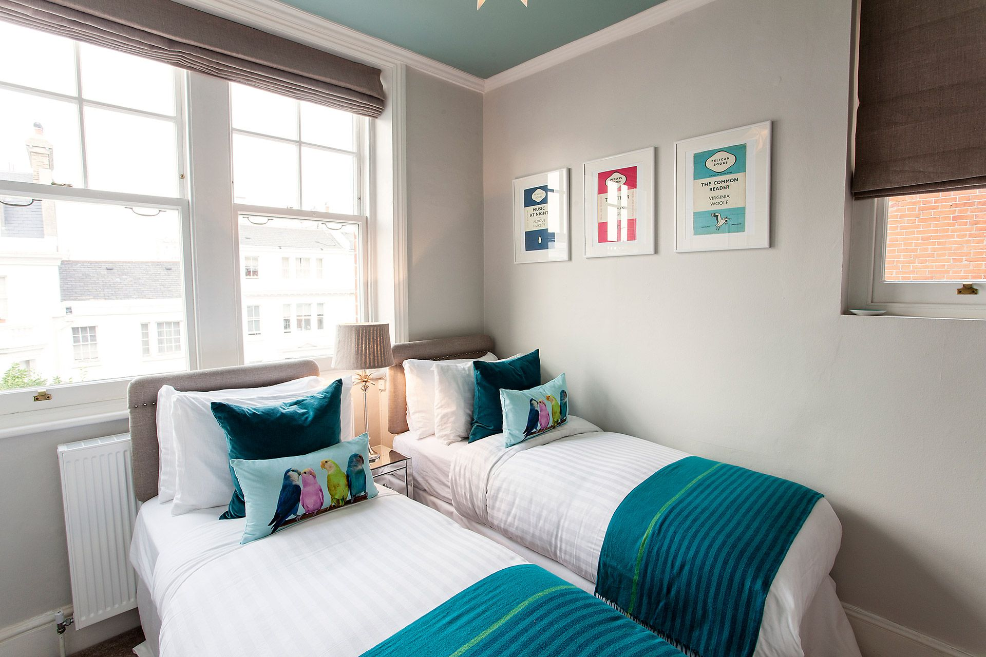 Cozy bedroom with a brilliant burst of colour in the Austen vacation rental offered by London Perfect