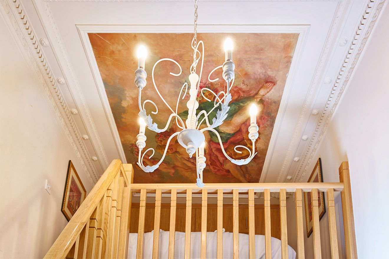 Original ceiling frescoes in The Queensgate Studio Loft vacation rental offered by London Perfect