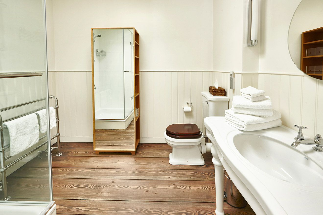 Wood accents in the bathroom pay homage to the home's historic foundation