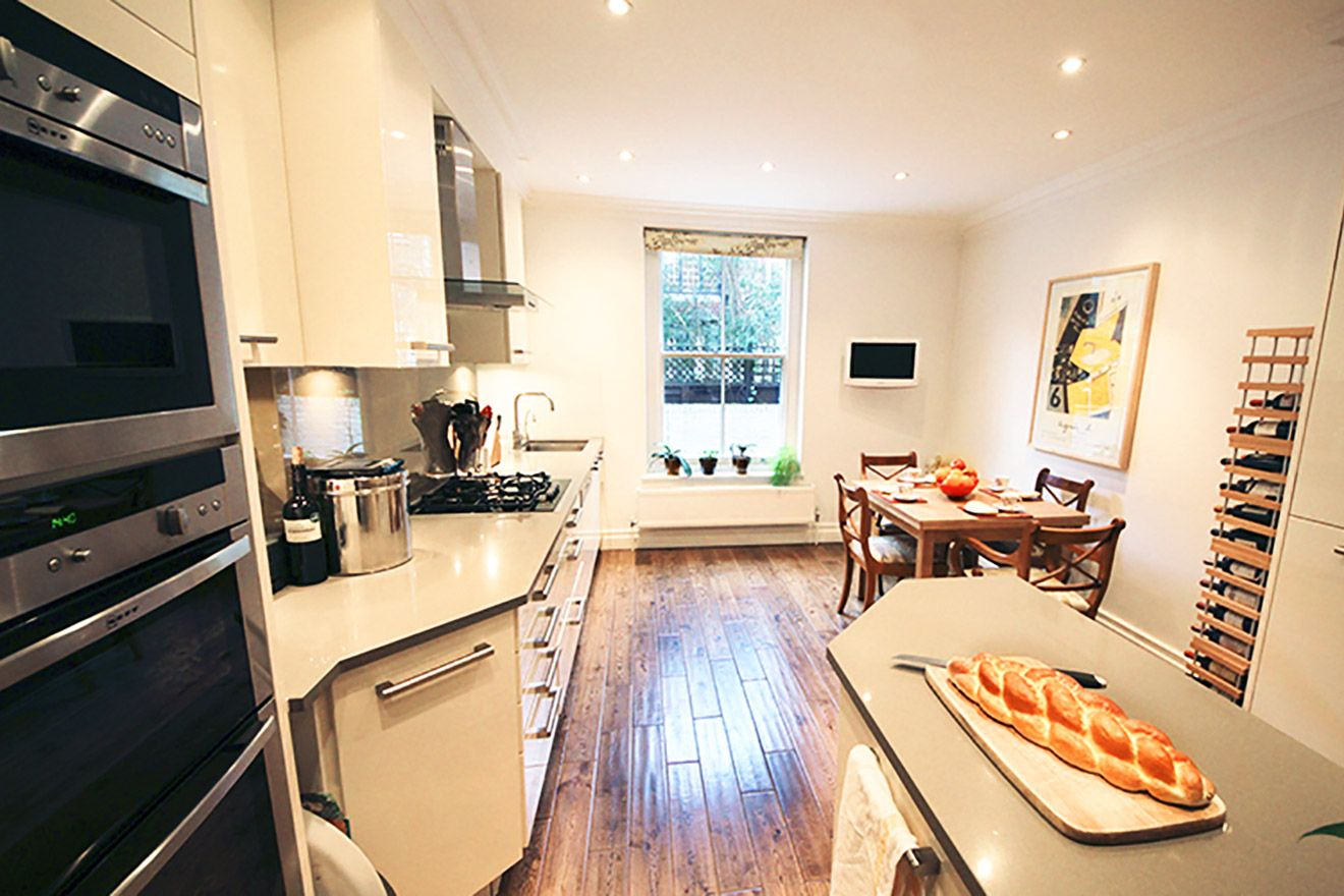 Gorgeous kitchen with large window and dining area in the Christchurch vacation rental