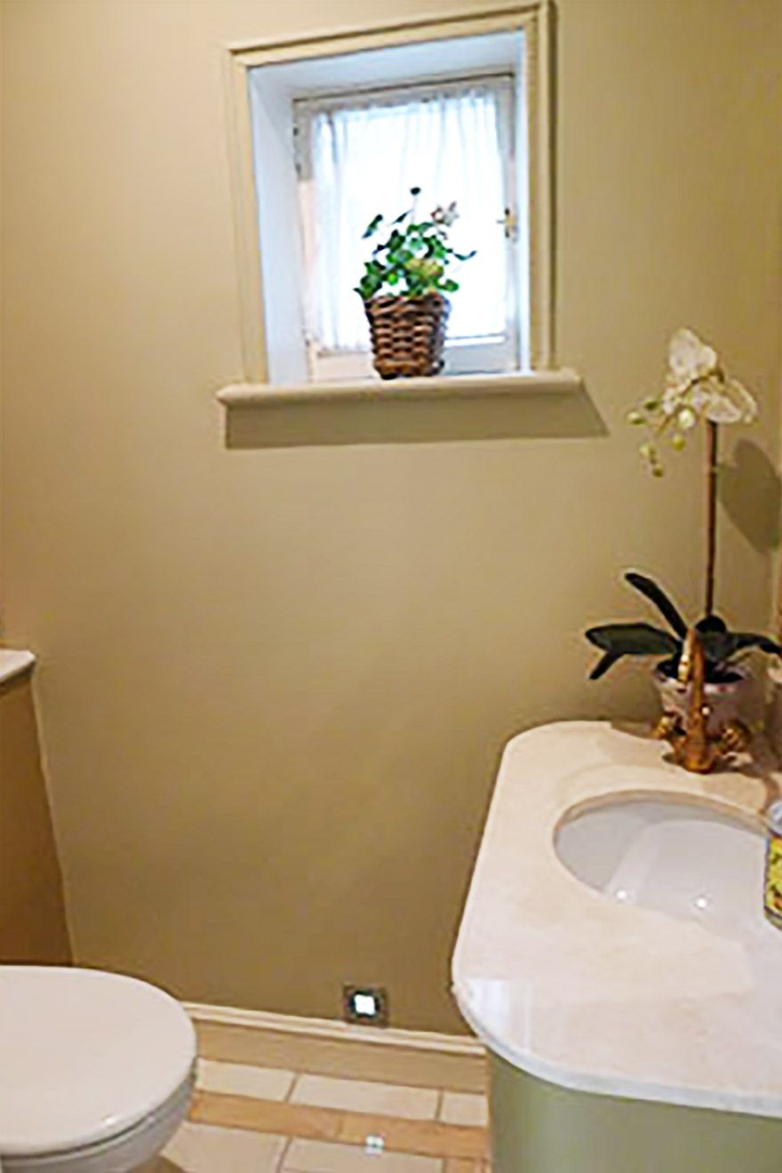 Half bath with toilet and sink in the Victoria vacation rental offered by London Perfect