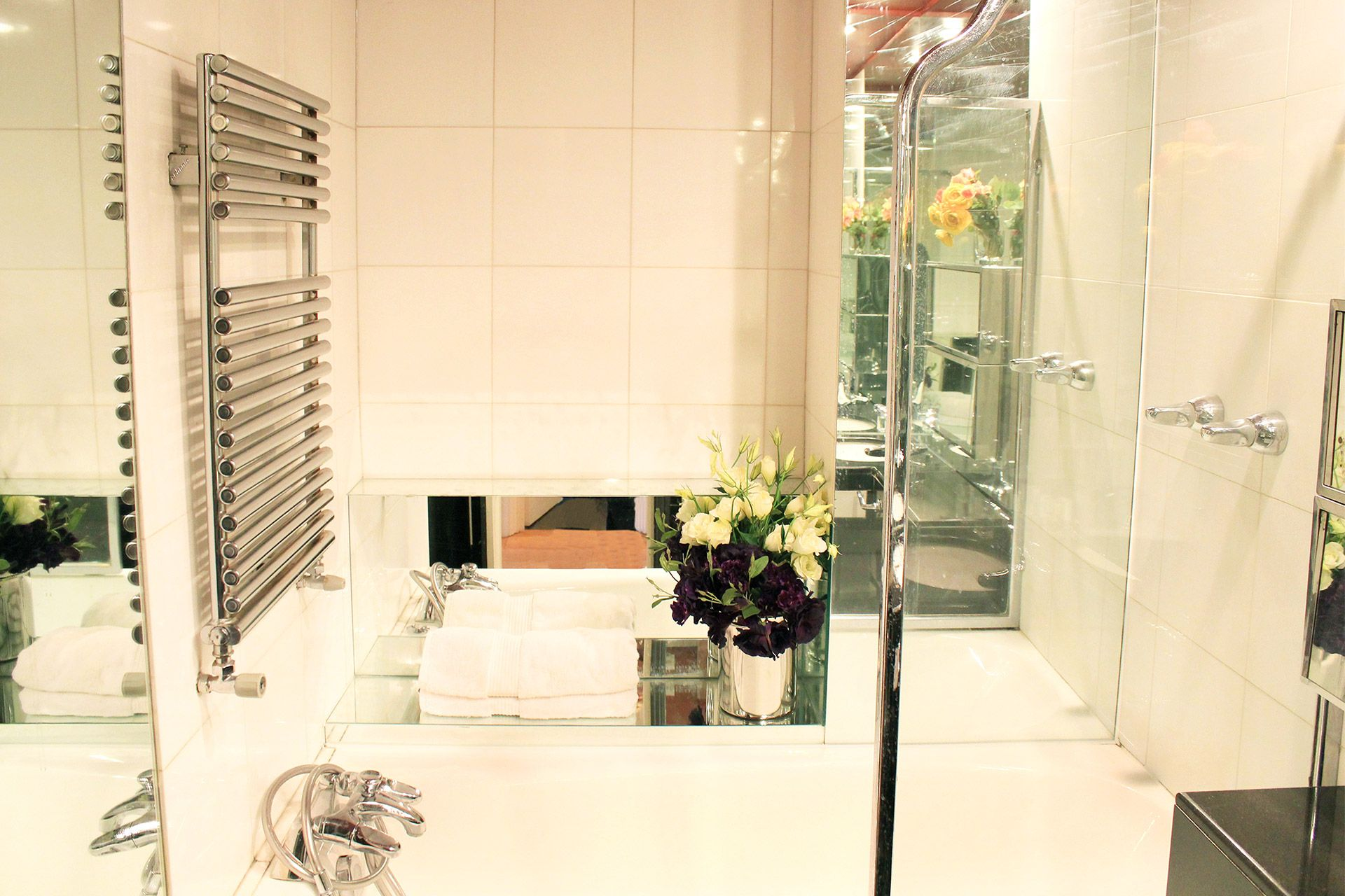 Heated towel rail in bathroom for warm towels