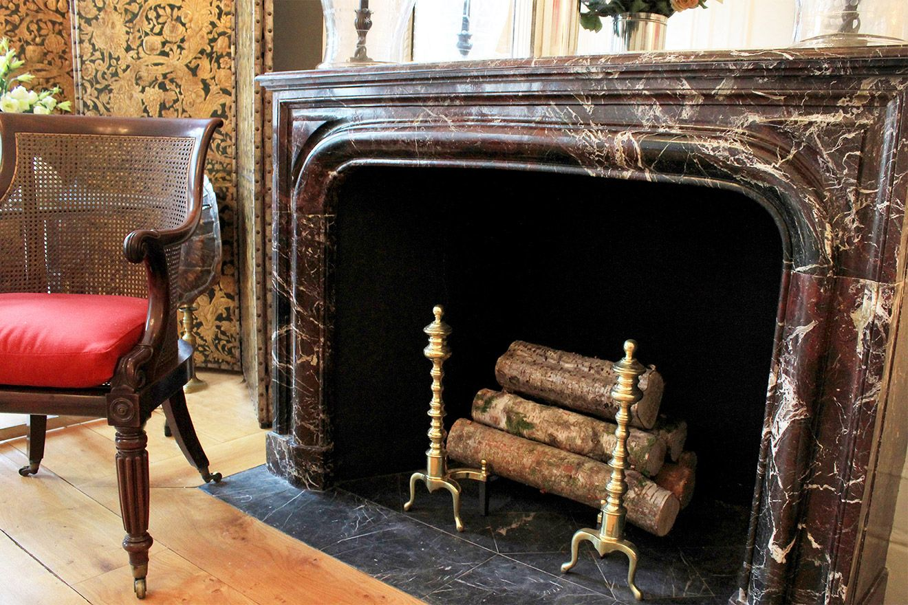 Gorgeous historic fireplace mantle in living room