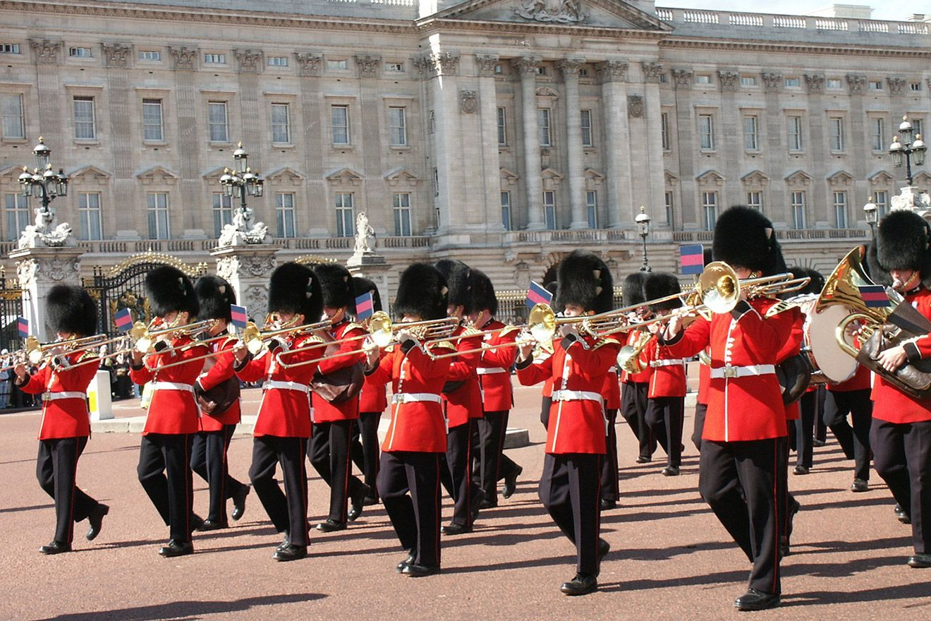 See the changing of the guards at Buckingham Palace