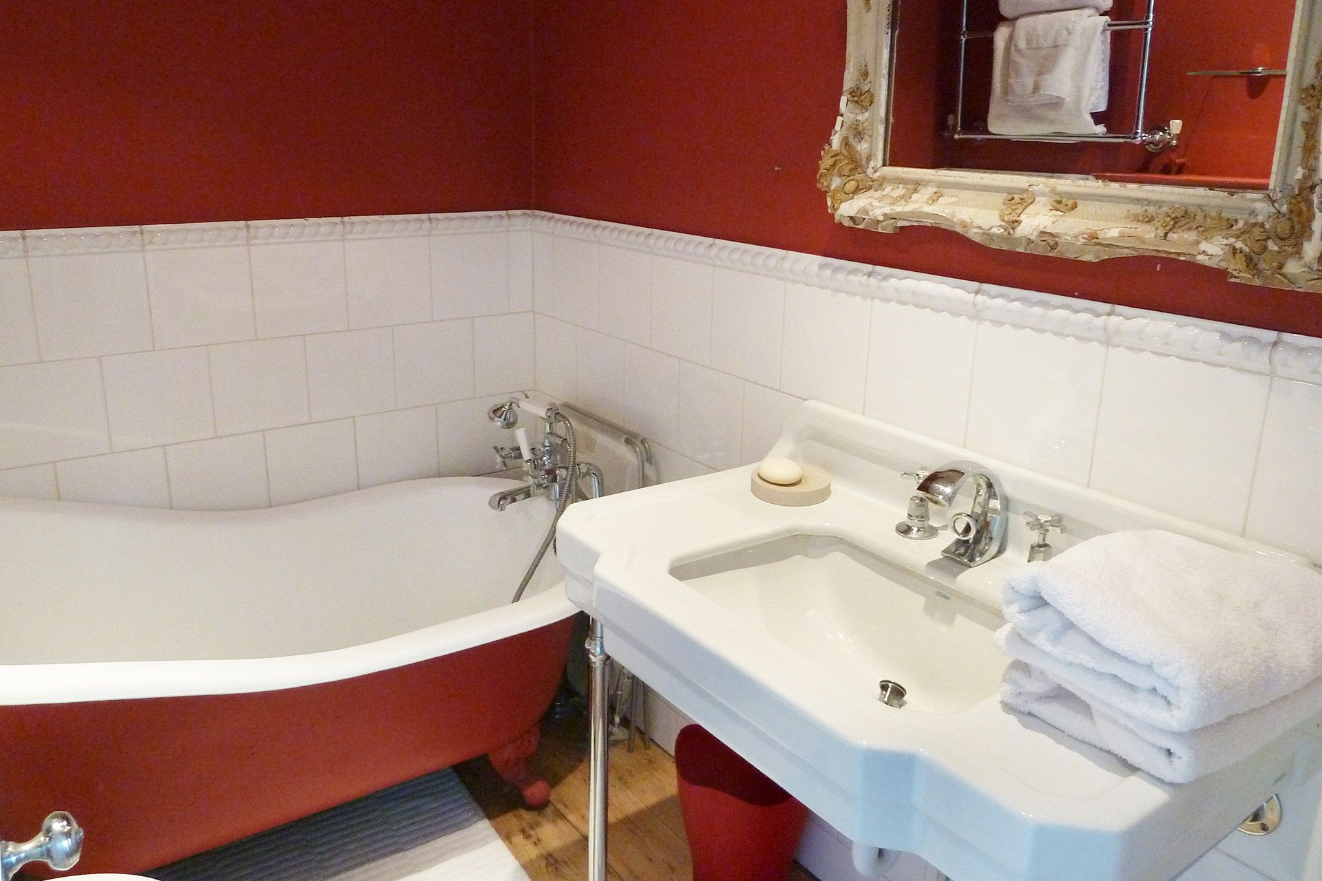 En suite bathroom to second bedroom claw foot iron bathtub