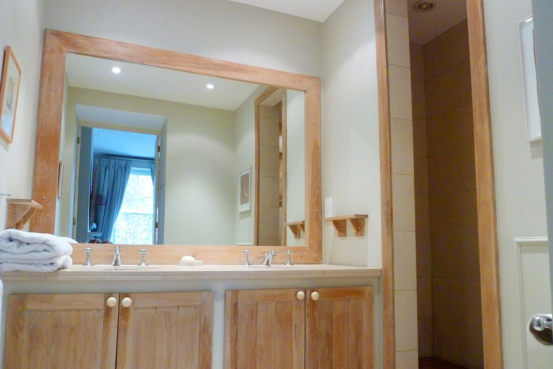 En suite master bathroom bleached wood cupboards