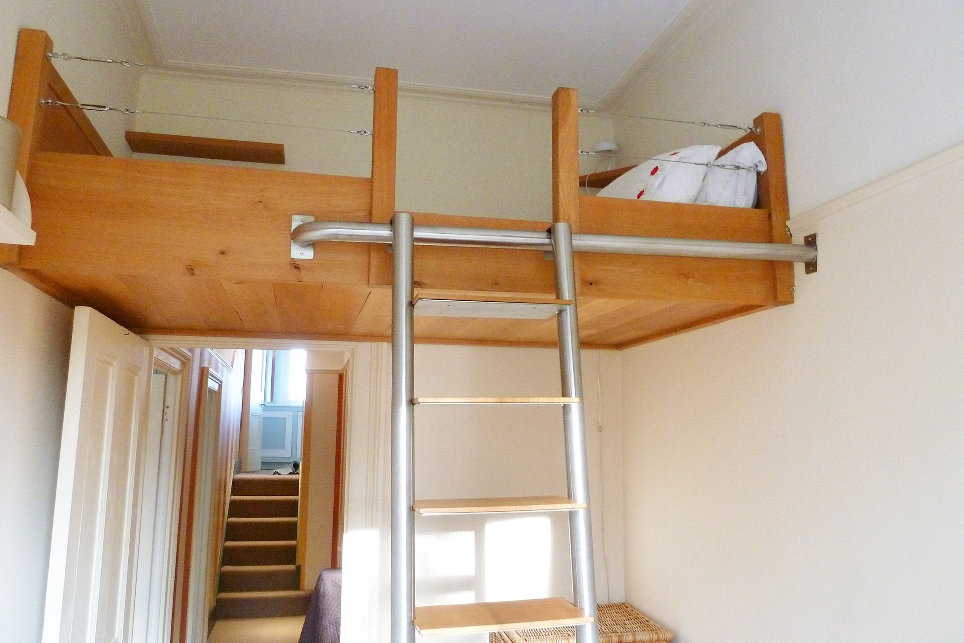 Loft bed with ladder in The Gloucester vacation rental offered by London Perfect