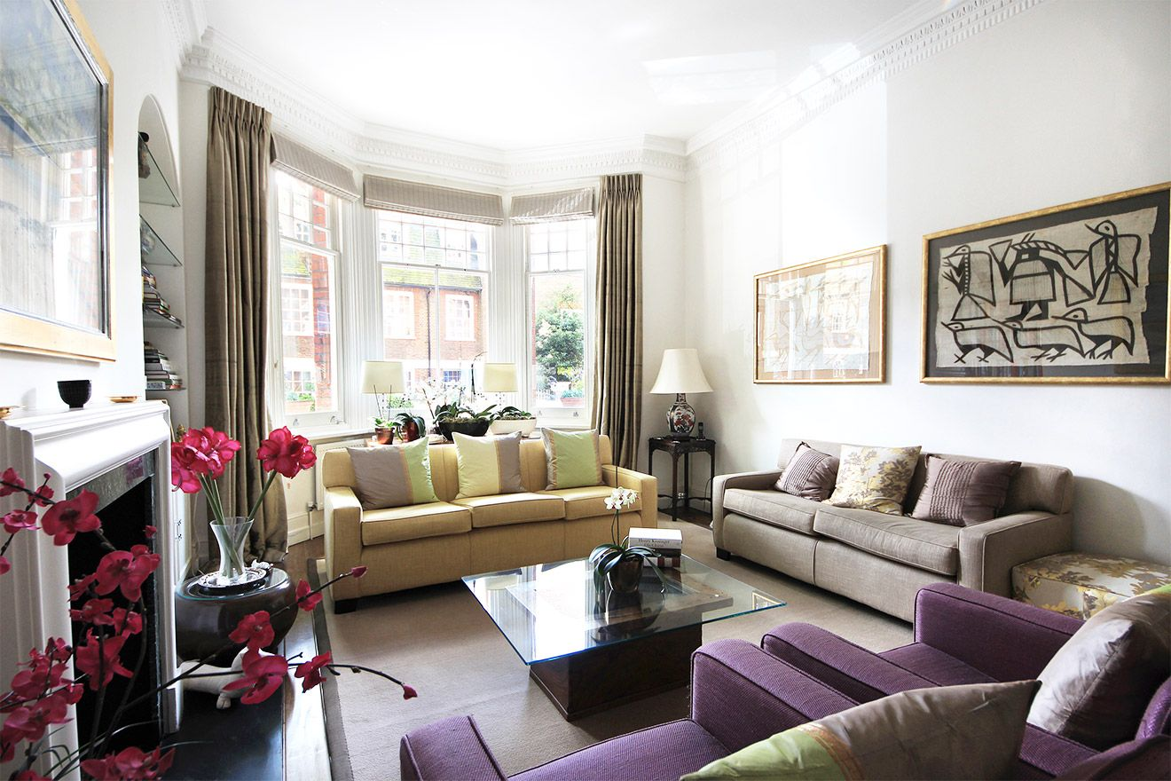 Beautifully decorated living room with large bay window in the Christchurch vacation rental