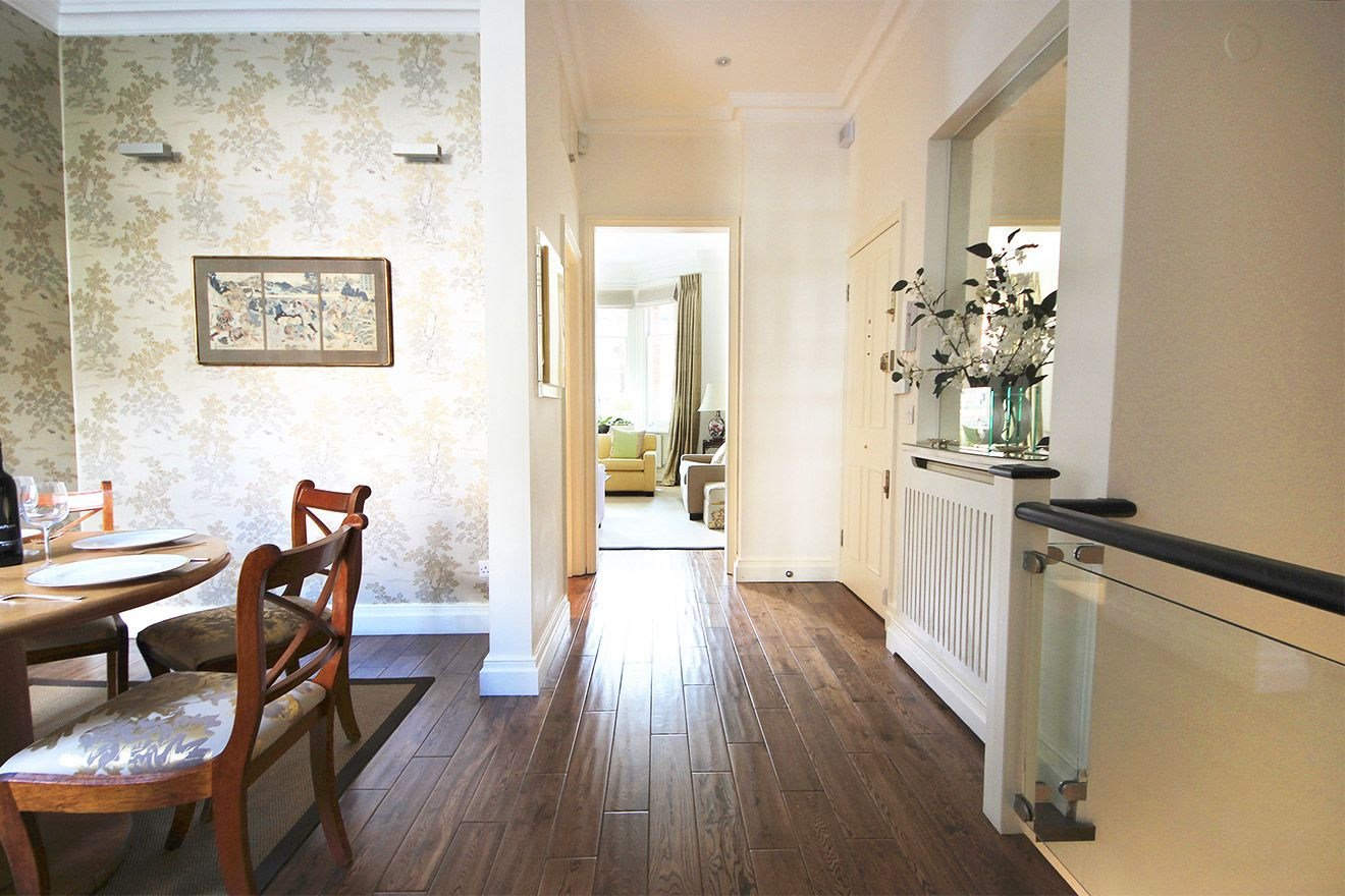 Hallway leads from living room to dining room and kitchen in the Christchurch vacation rental