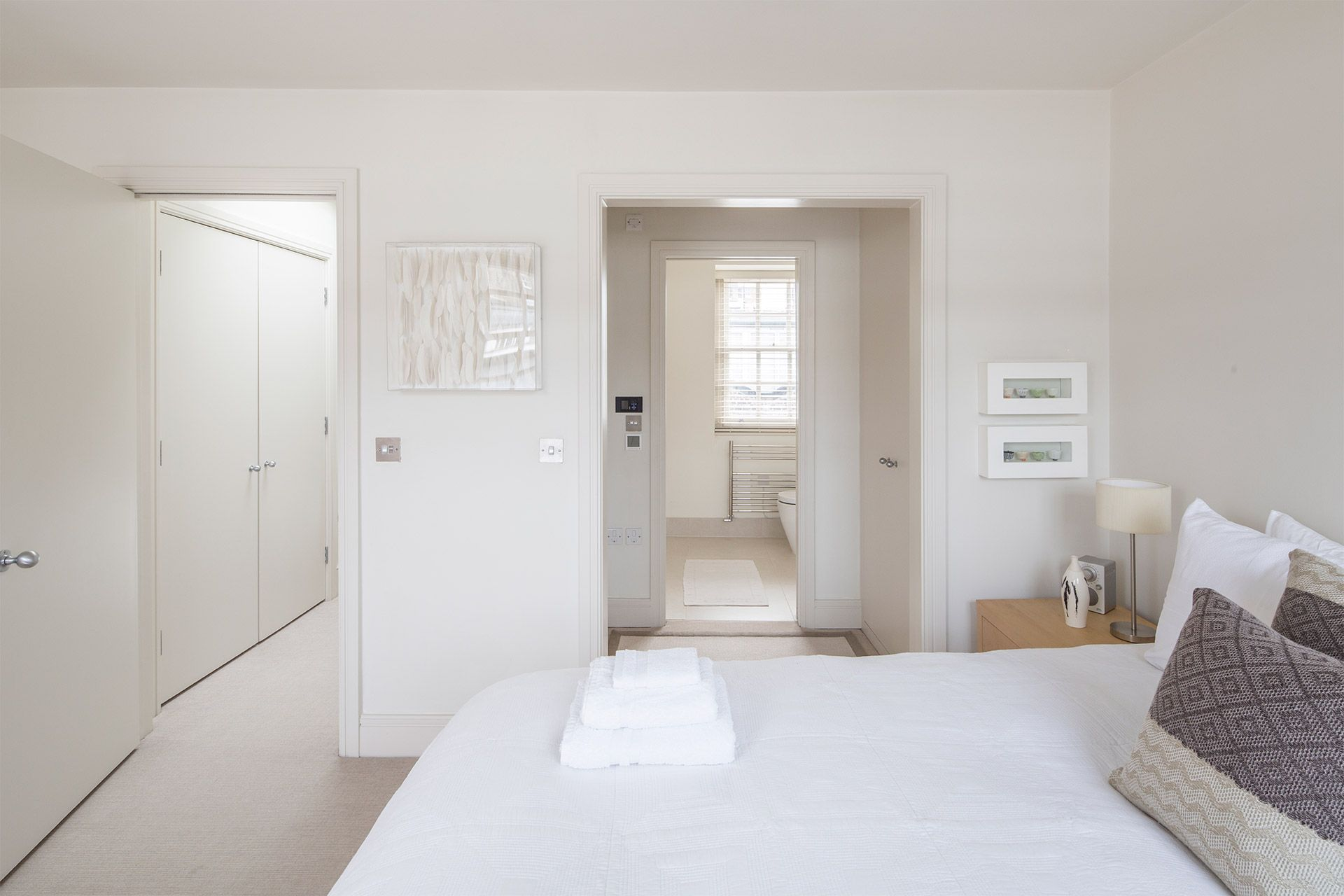 First bedroom with queen bed in The Walton vacation rental offered by London Perfect