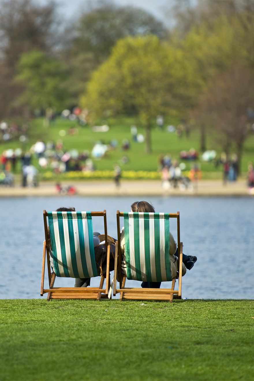 Deck chairs on sunny day in Hyde Park London