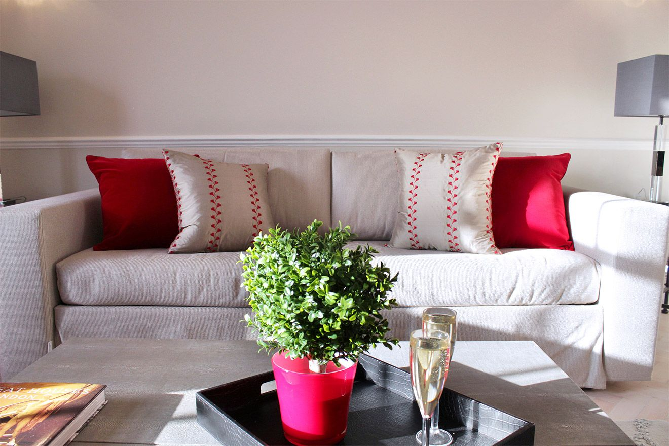Comfortable sofa in living room of the Leicester vacation rental offered by London Perfect