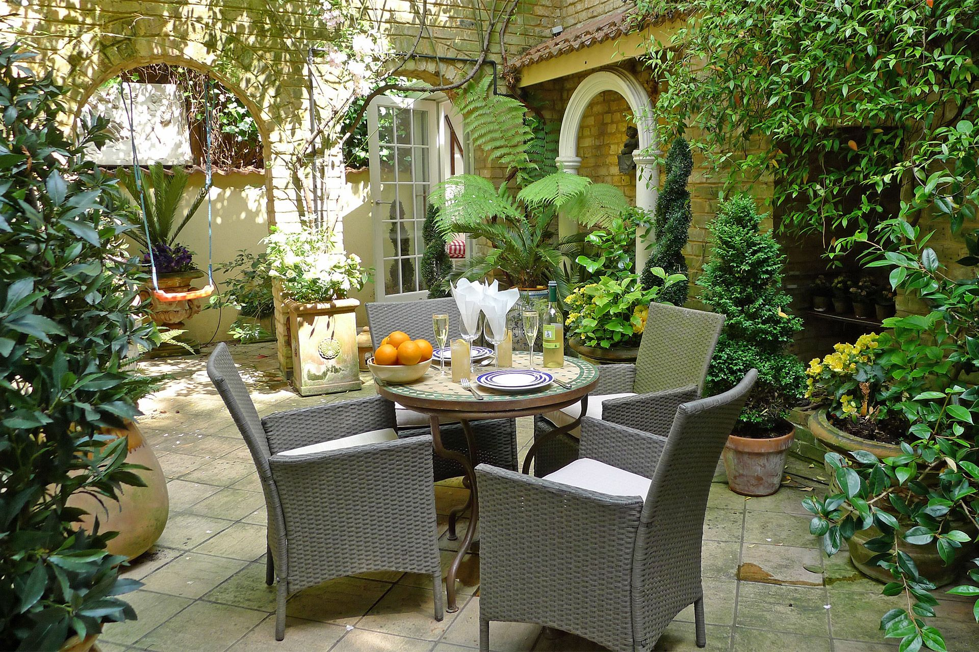 Relaxing patio garden of the Cornwall vacation rental offered by London Perfect & Kensington Vacation Apartment with Patio Garden