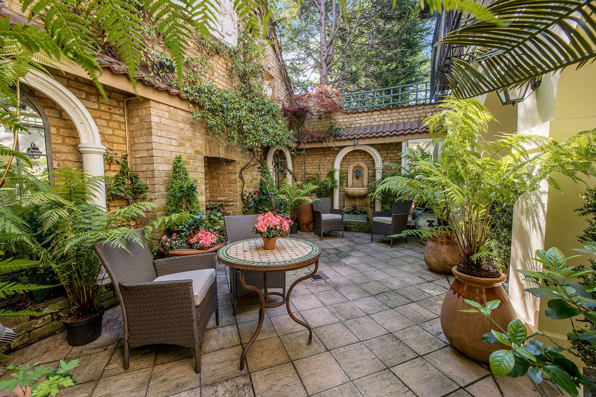 Seating area in the patio of the Cornwall vacation rental offered by London Perfect
