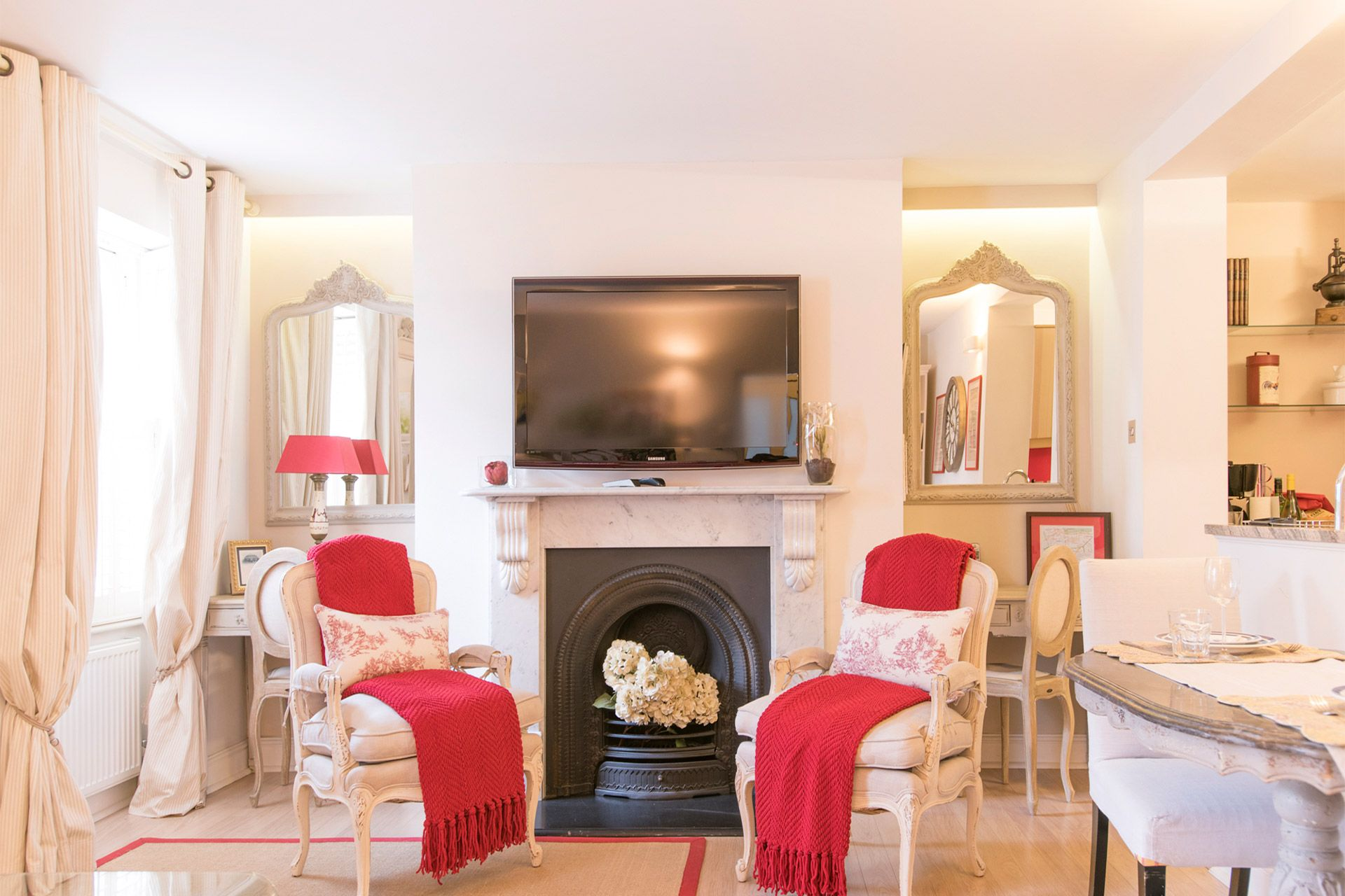 Marble fireplace with flat screen TV in the Cornwall vacation rental offered by London Perfect