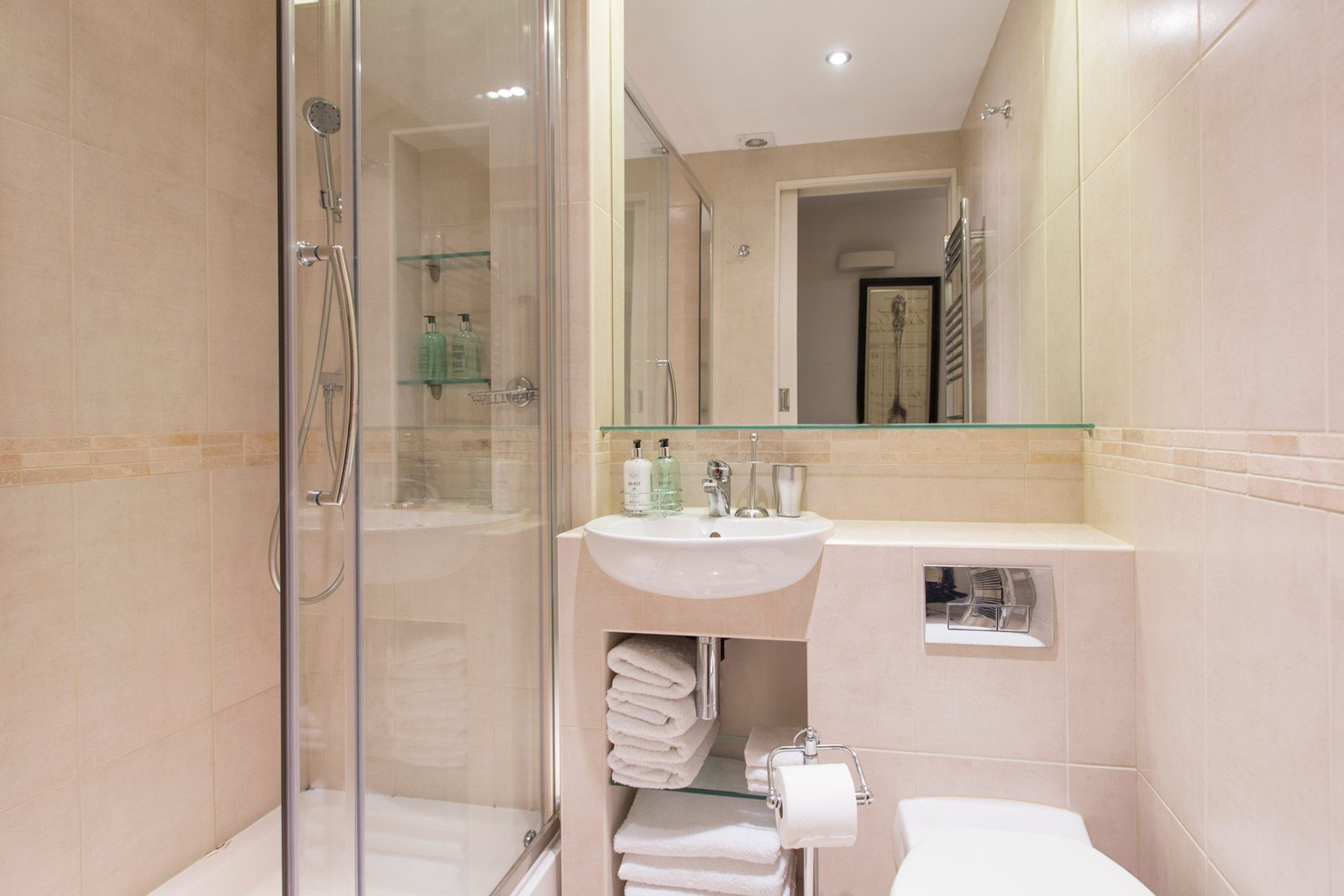 Bathroom featuring a large walk in shower, toilet and sink in the Cornwall vacation rental