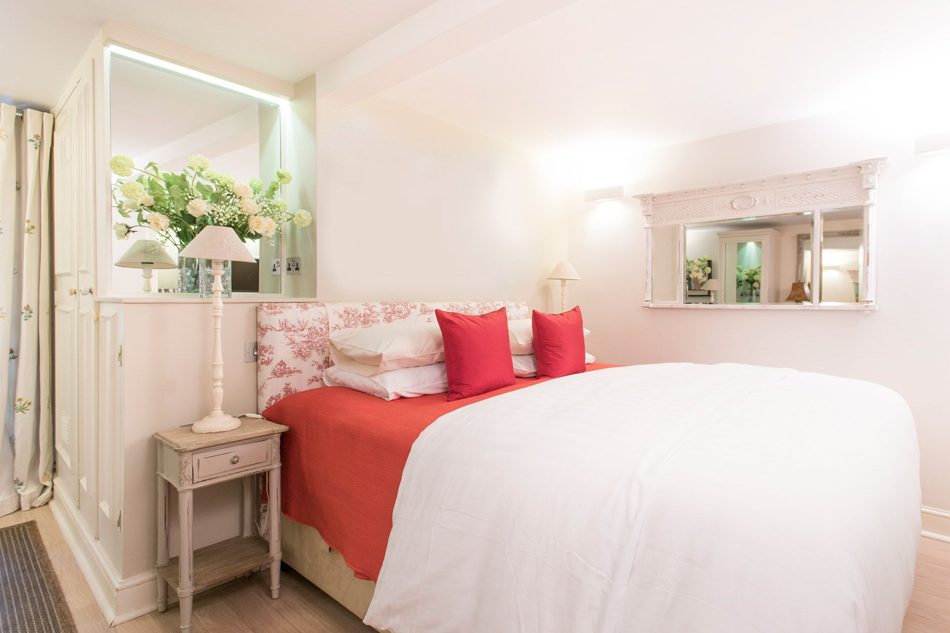 Beautiful bedroom with luxurious bed in the Cornwall vacation rental offered by London Perfect