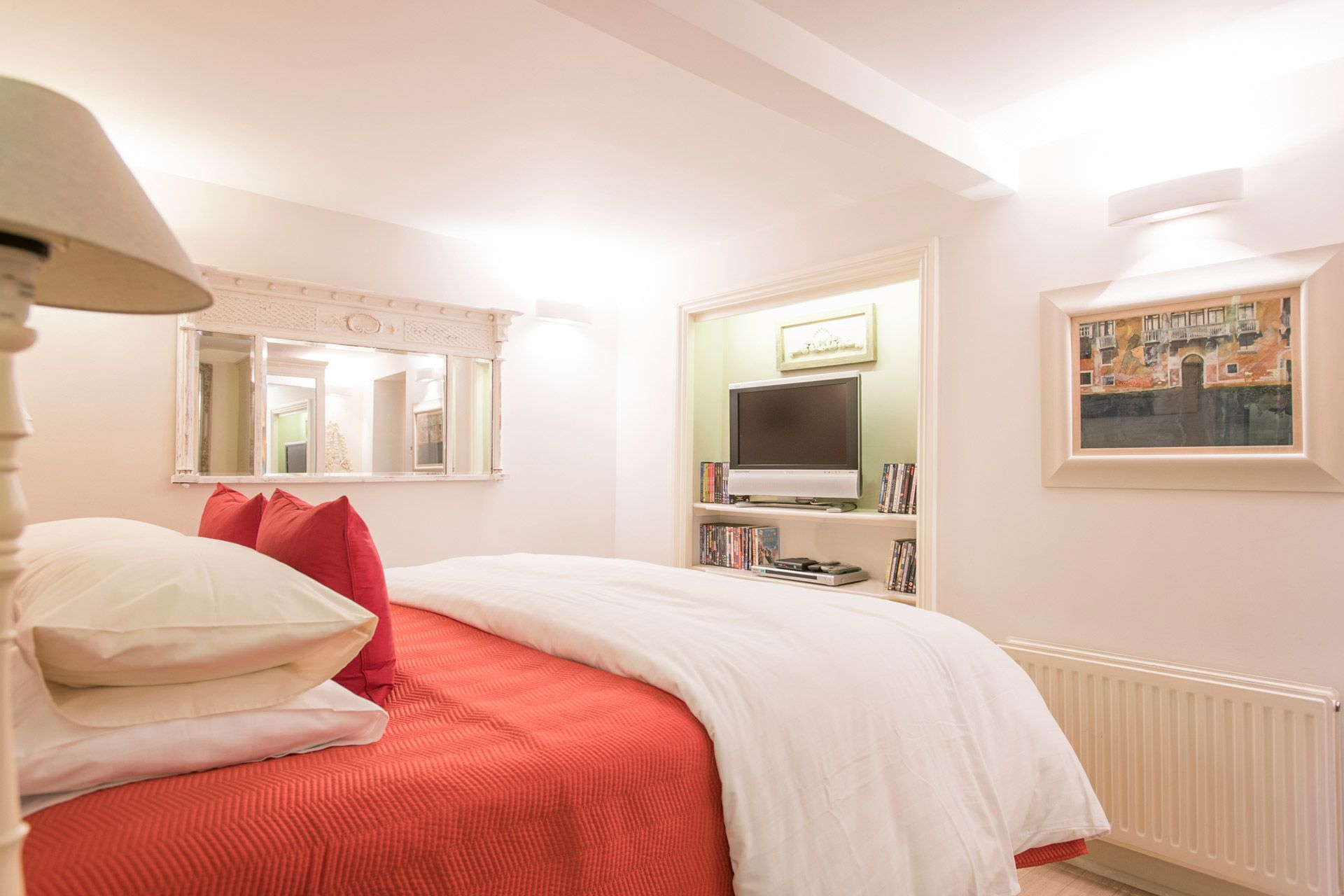 Flat screen TV in the master bedroom of the Cornwall vacation rental offered by London Perfect