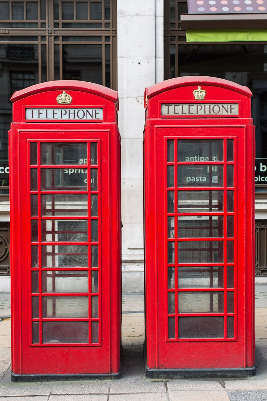 Two red phone booths in London