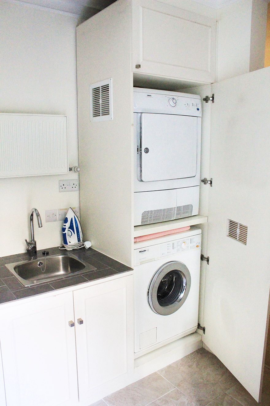 Laundry room with separate washer and dryer in the Christchurch vacation rental