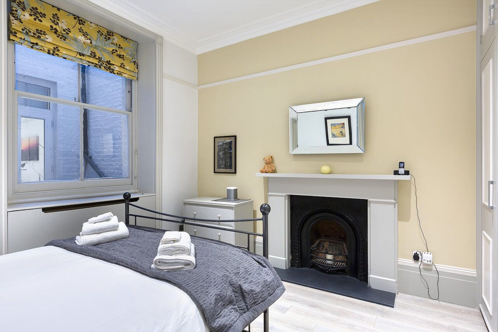 Fireplace in the bedroom of the Coleherne vacation rental offered by London Perfect