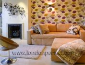 London apartment short term rental living room purple and green flower