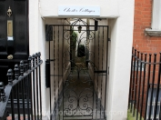 Decorative gate marks the entrance to a hidden mews in Chelsea