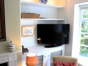Flat screen TV in living room of Chelsea mews home