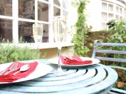 Dine al fresco in the pretty courtyard garden in London