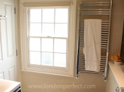 Large window fills the bathroom with light